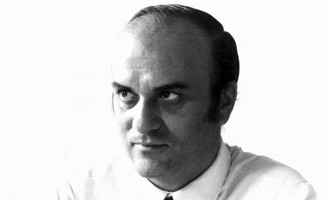 Black & White photo of Rodolfo Bonetto. He designed the Boomerang Chair in 1968 for Flexform. Today no longer in production.